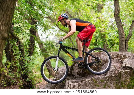 Extreme Cycling, A Cyclist Jumping On A Mountain Bike. Cyclist Riding A Mountain Bike In A Beautiful