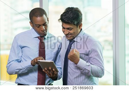 Excited Business People Reading Good News On Tablet Computer. Business Executive Showing E-mail On D
