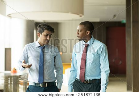 Serious Indian Businessman Sharing His Problems With Coworker. Upset Young Entrepreneur Talking To C