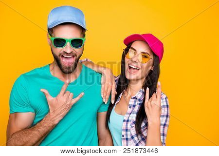 Portrait Of Funky Crazy Students In Modern Eyeglasses Gesturing Rock And Roll Symbols Isolated On Vi
