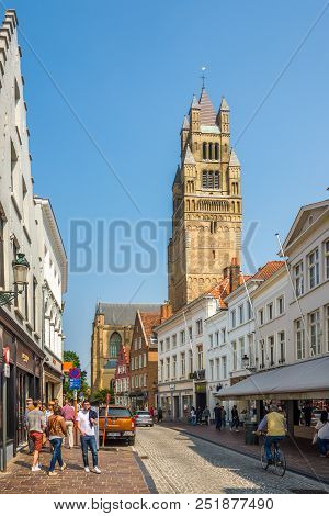 Bruges,belgium - May 20,2018 - In The Streets Of Bruges. The Historic City Centre Of Bruges Is A Pro