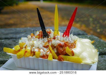 Traditional Belgian Fast Food, Fried Potatoes Chips With Mayonnaise, Sate Souse And Onion Served Out