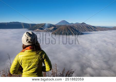 Woman Tourist Looking Beautiful Landscape During Sunrise At Mount Bromo Volcano (gunung Bromo) In Br