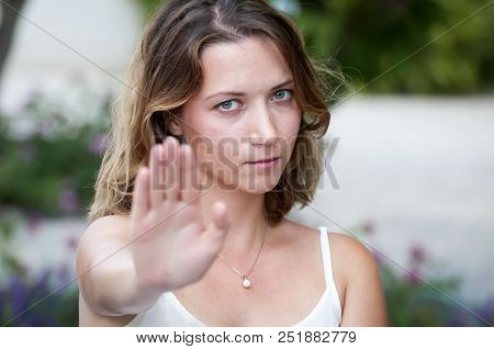 A Cute Blond Caucasian Girl Says No, Gives A Sign To Stop Inappropriate Behavior In The Street. Cour