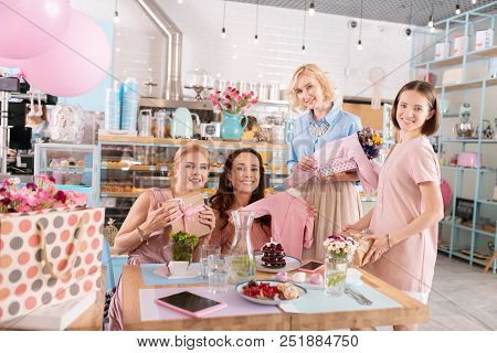 Decorated Event Agency. Four Appealing Friends Feeling Festive While Having Baby Shower In Decorated