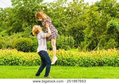 Happy Joyful Teen Couple Having Fun Outdoor In Green Park During Beautiful Summer Weather.