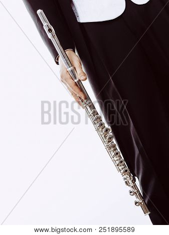 Classical Music Study Concept. Male Flutist Musician Performer With Flute. Young Elegant Man Wearing