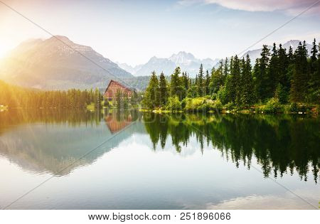 Calm mountain lake in National Park High Tatra. Location place Strbske pleso, Slovakia, Europe. Scenic image of most popular european travel destination. Summer vacation. Discover the beauty of earth.