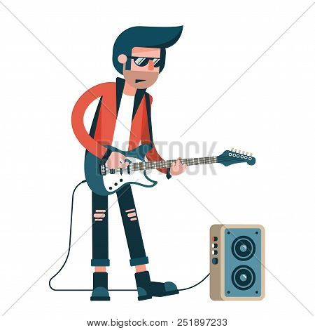 Rock Guitarist Plays Solo On An Electric Guitar Connected To A Combo Amplifier Speaker.