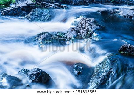 The Photo Of Small Waterfall Or Cataract In The Forest Taked In The Warm Sunny Summer Day With The L