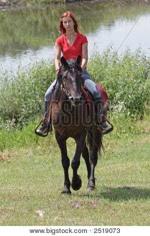 The Young Beautiful Girl Goes On A Horse On River Coast
