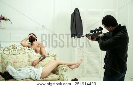 Husband found lovers, killed wife and threatening to bearded lover. Cheating and jealousy concept. Man at gunpoint of killer. Man with beard naked, miserable at gunpoint, interior background. poster