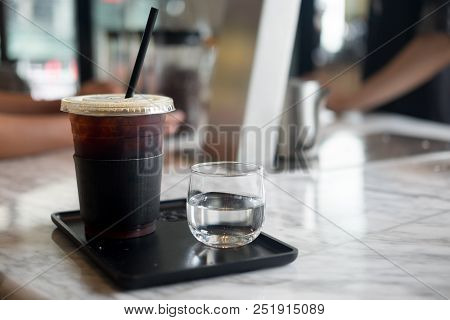 Fresh Cold Black Coffee Served With Cold Water