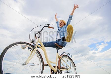 Woman Feels Happy While Enjoy Cycling. Girl Rides Bicycle Sky Background. How Cycling Changes Your L