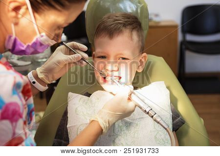 A Little Boy At A Dentist's Reception In A Dental Clinic. Children's Dentistry, Pediatric Dentistry.