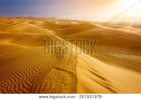 Sand dunes in the desert near Al Ain, UAE at sunrise