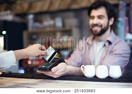 Middle-aged Man Working In A Coffee Shop Smiling Cheerful Taking Cashless Payment Close-up Woman Usi