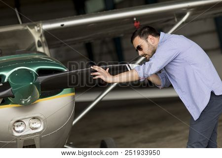 Young Pilot Checking Ultralight Airplane Before Flight