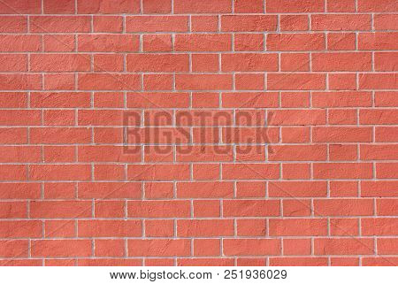 Brick Wall Pattern Of Red Stone Material Background. Abstract Bright Vivid Brick Stones Pattern, New