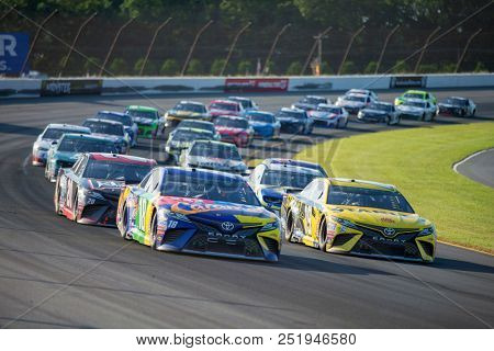 July 29, 2018 - Long Pond, Pennsylvania, USA: Daniel Suarez (19) races through the tricky triangle at the Gander Outdoors 400 at Pocono Raceway in Long Pond, Pennsylvania.