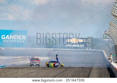July 29, 2018 - Long Pond, Pennsylvania, USA: Kyle Busch (18) races through the tricky triangle and wins at the Gander Outdoors 400 at Pocono Raceway in Long Pond, Pennsylvania.