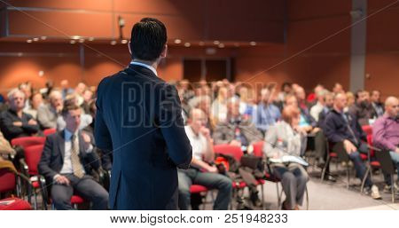 Speaker Giving A Talk On Corporate Business Conference. Unrecognizable People In Audience At Confere