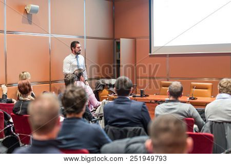 Public Speaker Giving A Talk At Business Meeting. Audience In The Conference Hall. Skilled Coach Ans