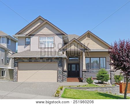 Luxury Family House With Wide Concrete Driveway, Double Garage And Landscaped Front Yard. Residentia