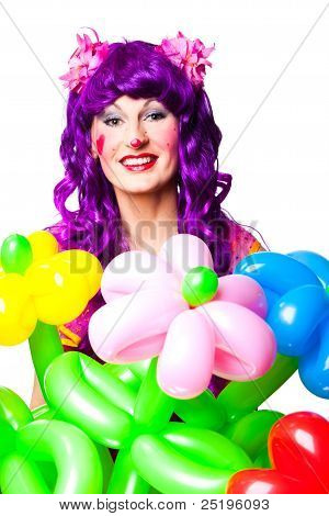 Female Clown With Colorful Balloon Flowers