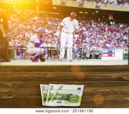 Euro Money Against The Background Of A Tv Showing Baseball, Sports Betting, Euro Money