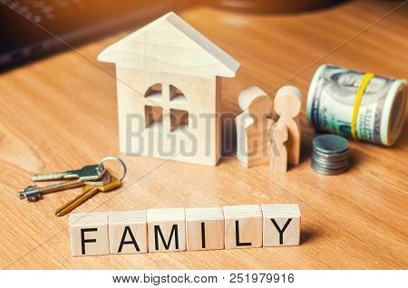 The Family With Money Is Standing Near Their House. Concept Of Wealth Life And A Happy Well-endowed.