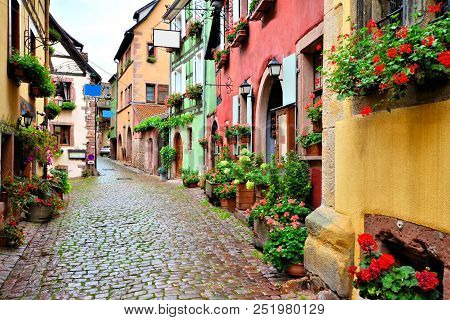 Picturesque Street In The Of The Town Of Riquewihr, Alsace, France
