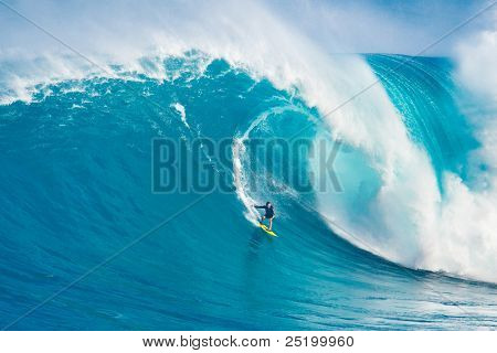 MAUI, HI - MARCH 13: Professional surfer Carlos Burle rides a giant wave at the legendary big wave surf break