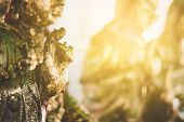 Gilding leaf on  buddha statue, religion belives poster