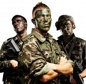 portrait of soldiers group with jungle camouflage over white poster