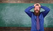 Man bearded teacher or educator hold head chalkboard background. Pay attention to your behaviour and manners. Teacher etiquette tips modern education professional. Teacher behaves unprofessionally. poster