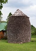 The Puhtitsa Dormition convent. Kuremae, Estonia. Baltic country. Woodpile. Firewood is laid in the form of stacks. The original masonry wood. poster