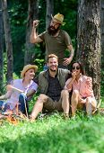 Unexpectable danger. Man brutal thief holds knife going attack hikers in forest. Friends relaxing and not expect to be attacked. Be careful. Company friends in dangerous situation in nature. poster