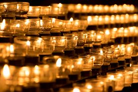 Group Of Grief Candles In Church For Obituary Faith Resurrection. Candle Is Symbol Of Sacrifice For