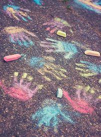 Color Hand Prints On Pavement. Happy Childhood Concept