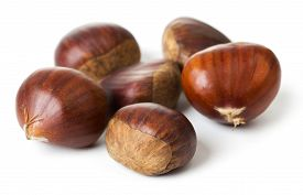 Heap Of Edible Chestnuts Isolated On White Background