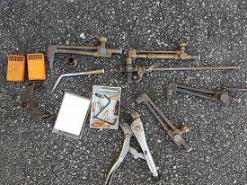 Old Worn Used Tools On Ground