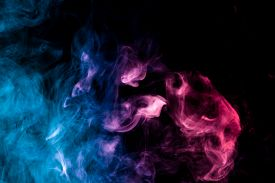 Thick Colorful Blue, Pink And Purple Smoke On A Black Isolated Background. Background From The Smoke