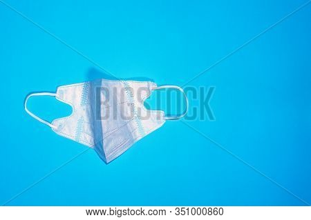 Face Mask Protection On A Blue Background Against Pollution, Virus, Flu And Coronavirus, Medical Bus