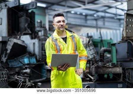 Men Industrial Engineer Wearing Uniform Standing In A Heavy Industrial Factory Behind He Looking New