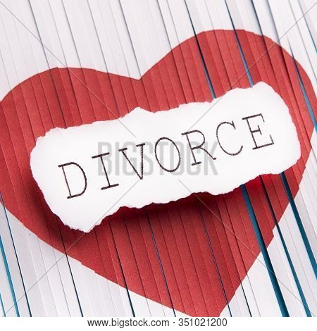 Divorce Concept. Cut Heart On White Sheet Of Paper, Background, Divorce Big Text