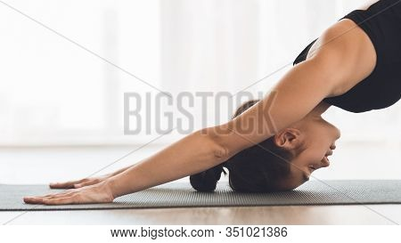 Hatha Yoga. Beautiful Young Woman Stretching In Childs Position, Doing Exercise, Balasana Pose, Work