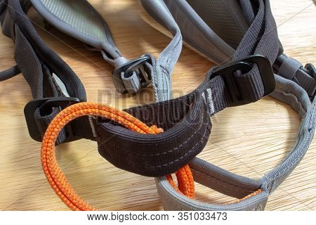 Closeup On A Rock Climbing Harness, Focusing On The Bealy Loop, Waist Straps And Leg Loop.