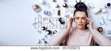 Young woman over white background with pills