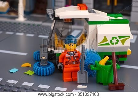 Tambov, Russian Federation - January 17, 2020 Lego Cleaner Minifigure With Shovel Near Sweeper Truck